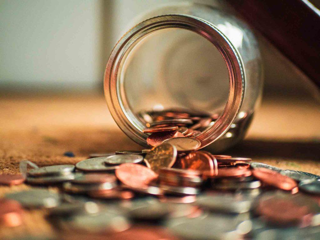 Money Jar Spill on Floor